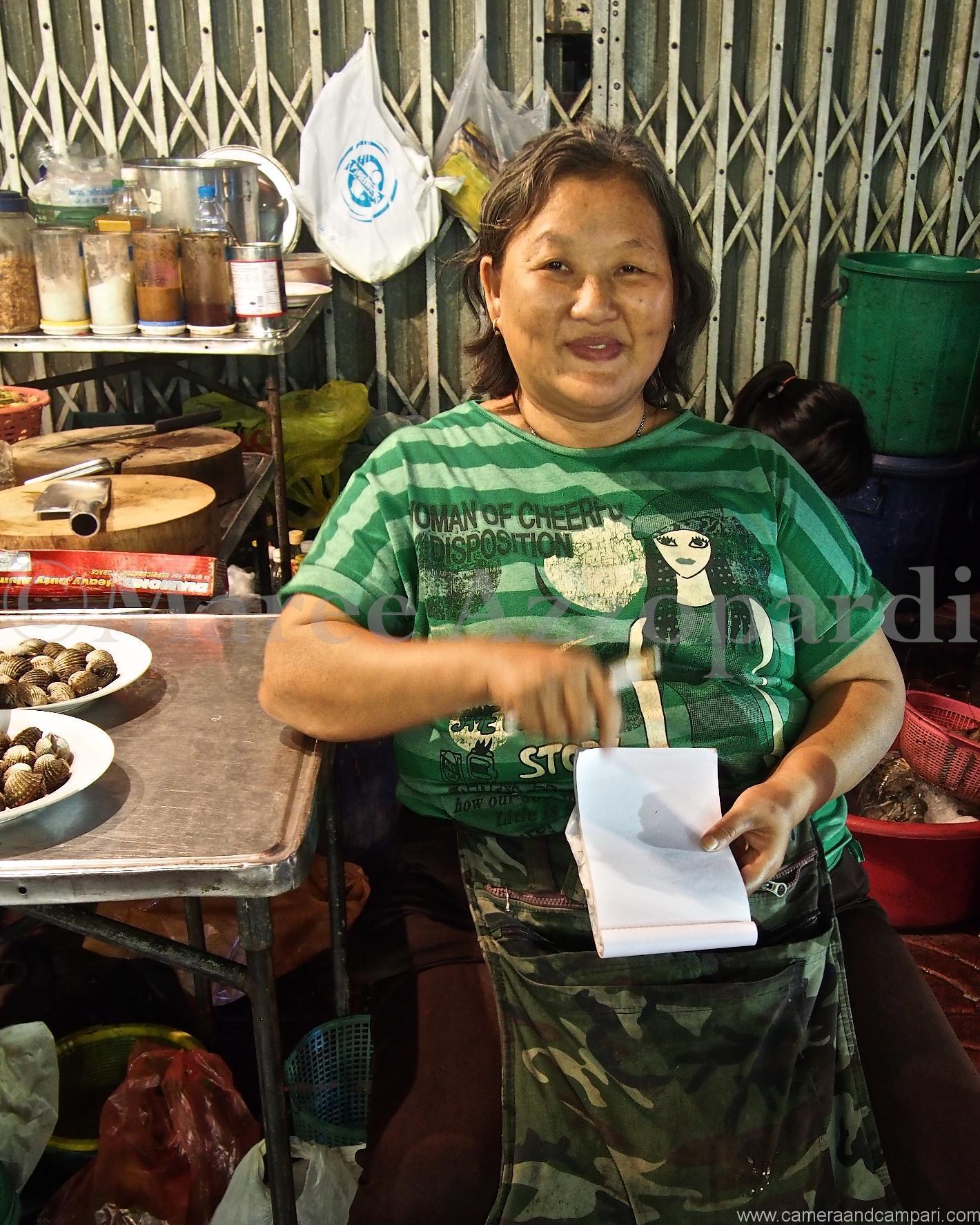 Smiling street food bosses in Chinatown Bangkok
