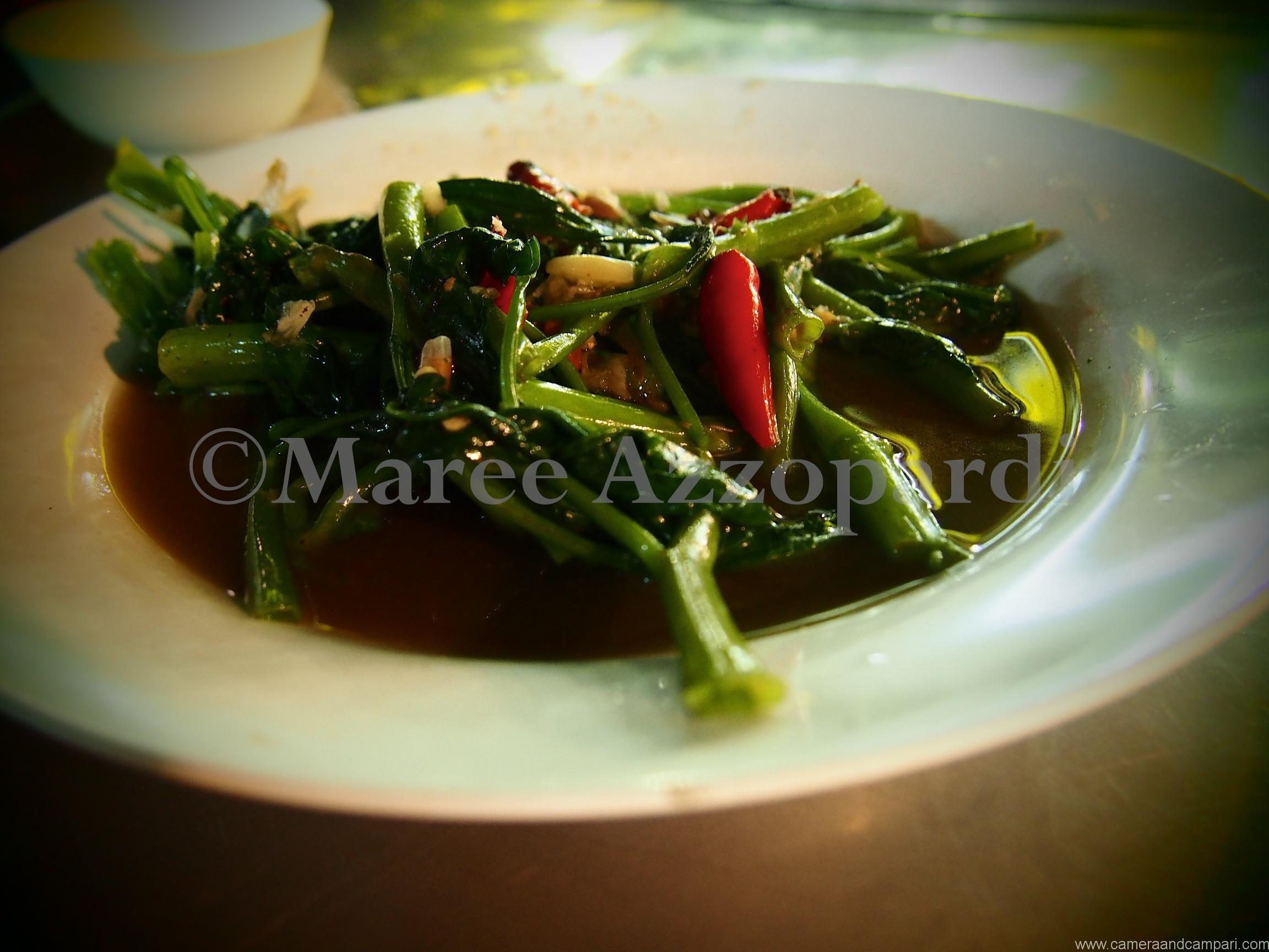 A plate of chilli fried morning glory (water spinach).
