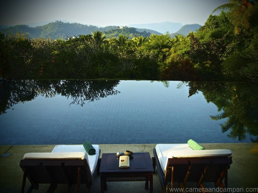 The infinity pool at La residence Phou Vao overlooking the golden temple-crowned Phousi Mountain.