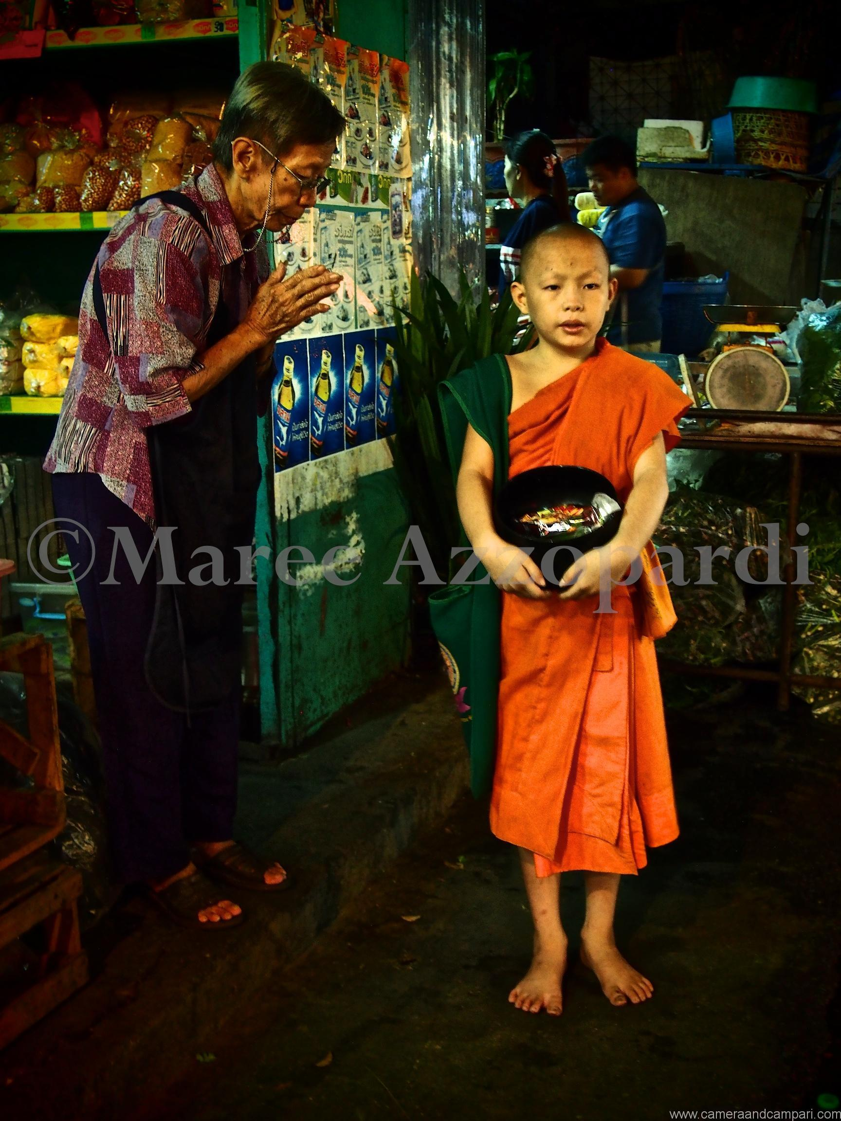 Young Buddhist Monk at markets, Chiang Mai, Thailand.