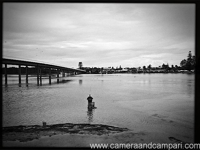 A lone fisherman near The Entrance Bridge.